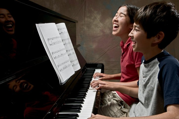 boys playing piano duets